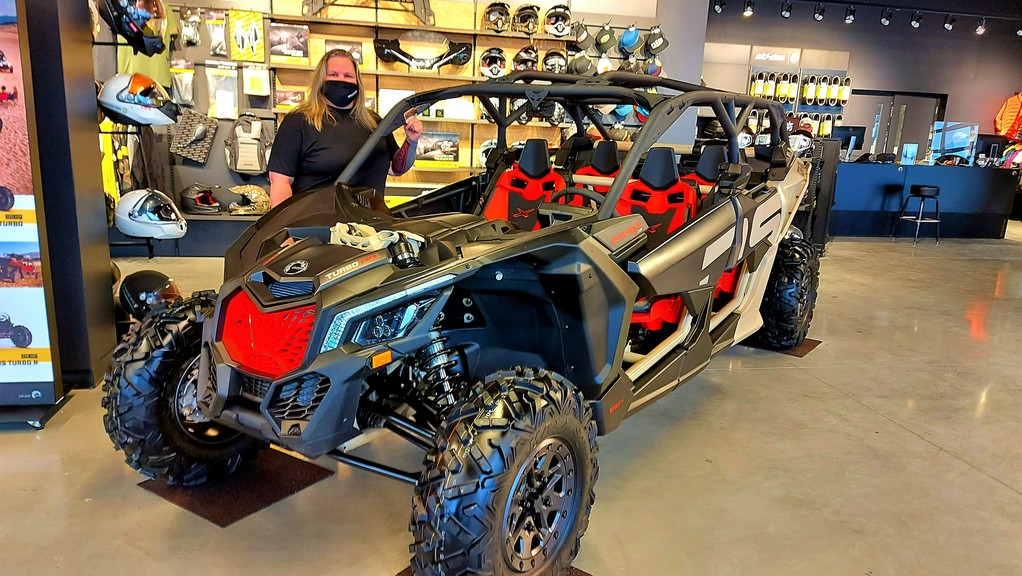 Torque Motorsports general manager Jen Landry stands behind a Can-Am Maverick X3 XDS side-by-side at the new 13,000-square-foot Hanwell location, which opened Monday on Greenview Drive.