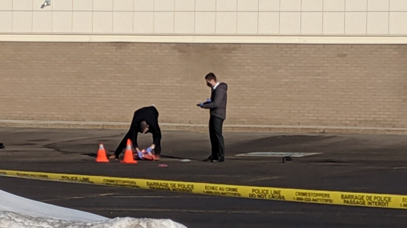 Members of the RCMP collect evidence at the scene of a hit-and-run that killed Javin Melanson, 19, outside Dooly's Billiard Room on Elmwood Drive on March 12.