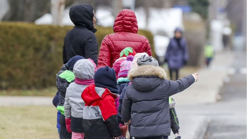 Children walk down a street in this file photo from Montreal.