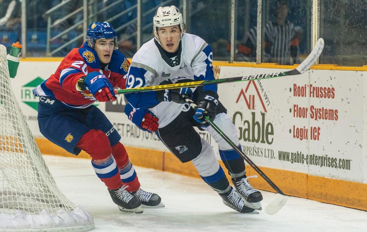 Moncton Wildcats defenceman Charles-Antoine Pilote, left, seen defending Nicholas Girouard of the Saint John Sea Dogs in a game last season, tallied two points in a QMJHL exhibition loss to the Halifax Mooseheads on Friday.