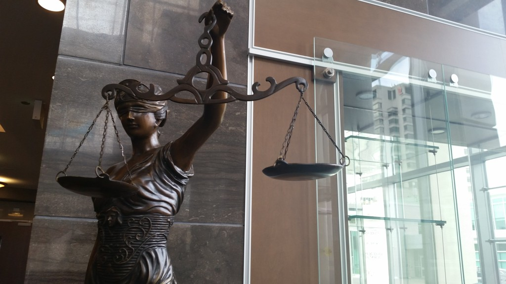 A statue of Lady Justice at the Saint John Law Courts.
