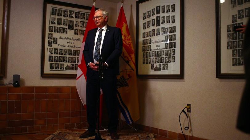 Premier Blaine Higgs speaks to reporters at the New Brunswick Legislature.