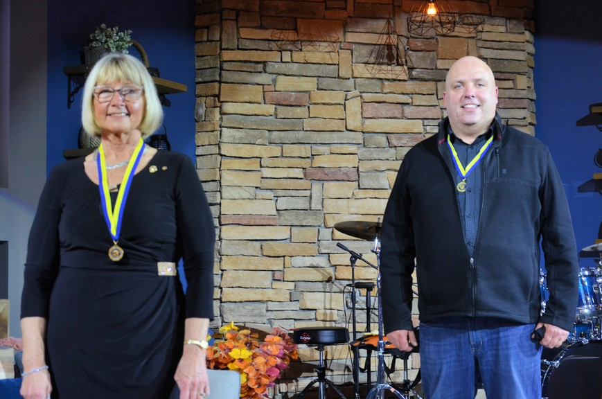 Catherine Flett, left, and Kevin Matthews received Paul Harris Fellow Awards from the Rotary Club of Miramichi in a virtual presentation March 31 at The Point Church.