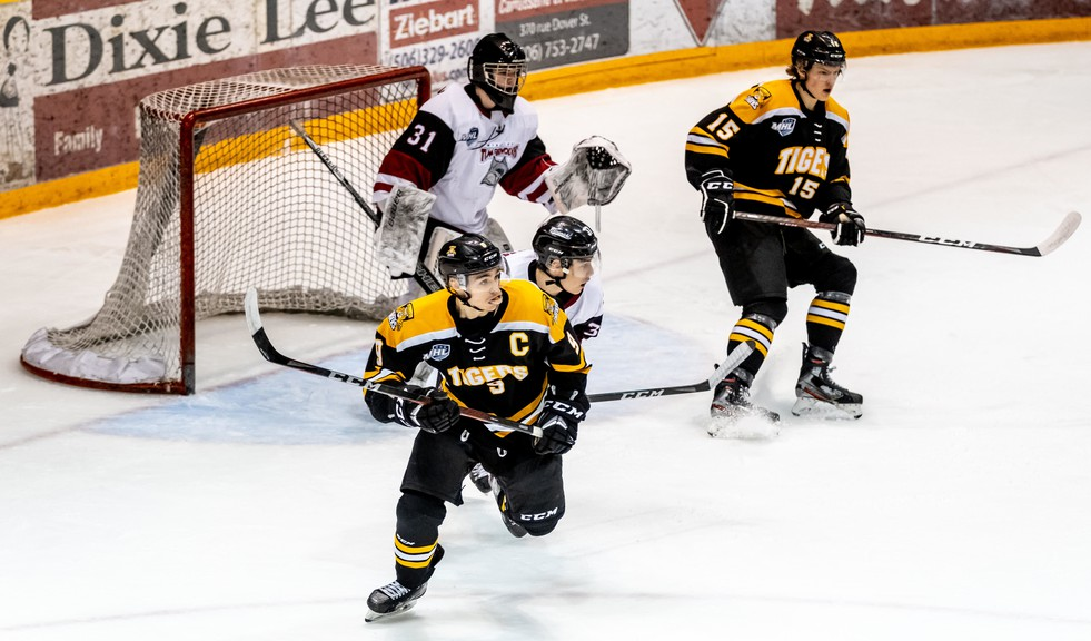 Campbellton Tigers Coleton Perry (9), and Adam Bowness (15), and Miramichi Timberwolves Jett McCullum (37) wait for a shot in front of goalie Kenzie MacPhail (31) on April 7 at the Memorial Civic Centre in Campbellton