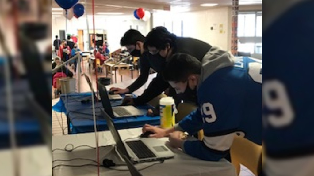 Students at Bonar Law Memorial High School at the school's voting station set up in support of Elsipogtog First Nation's bid in the Kraft Hockeyville contest.