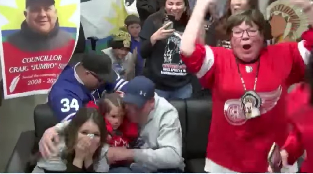 Members of Elsipogtog First Nation celebrate the community's Kraft Hockeyville victory Saturday night. The victory came a week after fisherman and band councillor Craig (Jumbo) Sock and community member Seth Monahan were lost at sea.