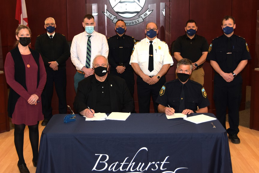 The City of Bathurst and Bathurst Professional Firefighters Association have signed a new collective agreement.  Pictured in the front row from left: Acting Mayor Lee Stever and Bathurst Professional Firefighters Association President Gregory West. Back row: City Clerk Wanda St-Laurent, Deputy Fire Chief Danny Boucher, City Solicitor Marc-André Laplante, Bathurst Professional Firefighters Association Vice-President Roger Hachey, Fire Chief Marc Arsenault, City Manager Todd Pettigrew and Bathurst Professional Firefighters Association Secretary Matthew Scott.