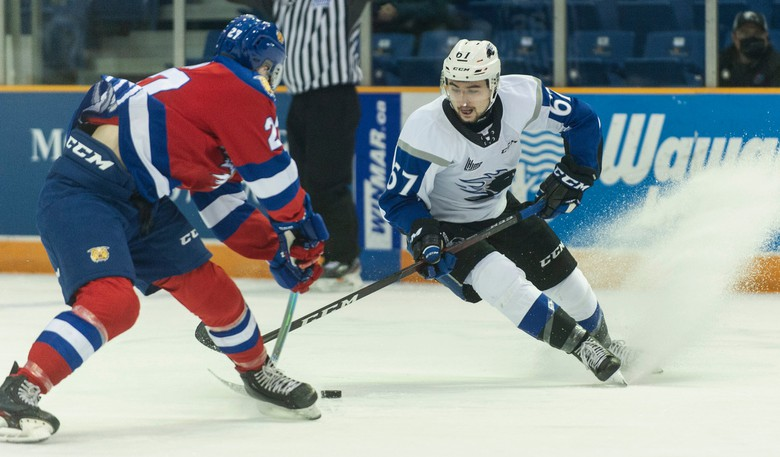 Zachary Alchorn of the Saint John Sea Dogs, right, fights for a puck with Connor Olson of the Moncton Wildcats during QMJHL action last season. The teams clash in an exhibition game on Thursday in Fredericton.
