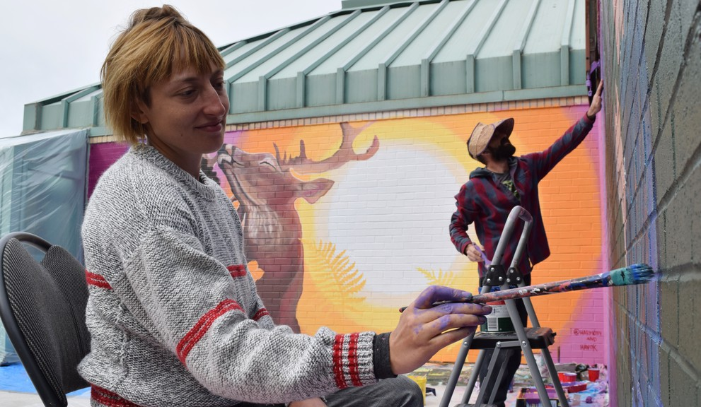 Jaclyn Martinez and Matthew Williston touch up the mural they painted in 2020 on the Chatham Public Library as part of a project between Moncton's Festival Inspire and New Brunswick-based recycling organization Encorp Atlantic. Festival Inspire will return to Miramichi this year and visit seven other communities as part of a province-wide tour.