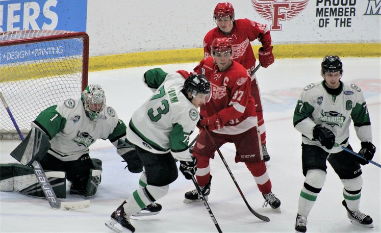 The Fredericton Red Wings and Grand Falls Rapids, shown in Maritime Junior Hockey League action last season at the Grant-Harvey Centre, play an exhibition game there Friday at 7 p.m.