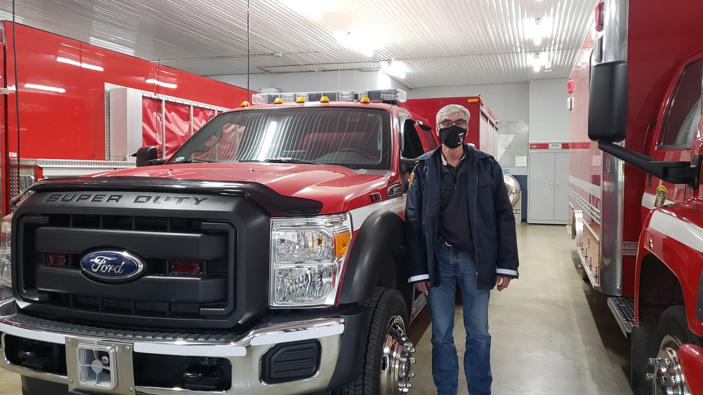 Harold McLellan, chief of the Woodstock Fire Department, stands beside the department's Jaws of Life rescue truck. Firefighters are looking at upgrading this unit to a larger medium-duty chassis, and using the existing truck to tow the new off road rescue equipment.