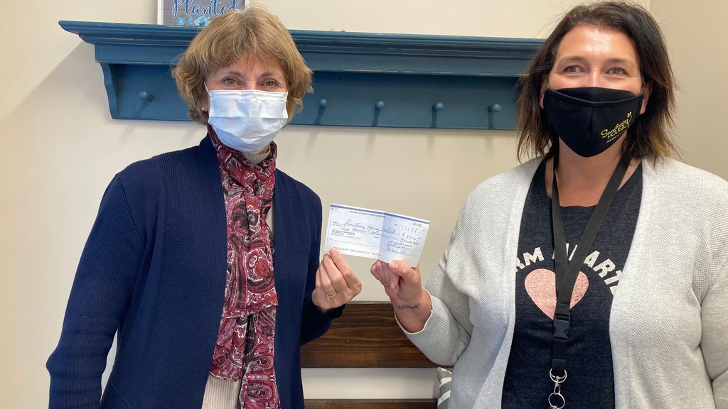 The Rotary Club of Perth-Andover recently donated $2,000 to Sanctuary House in Woodstock for the purchase of a wooden playhouse, a storage unit, children's bicycles and helmets. From left are Rhonda Kennedy, club president, and Rebecca Bubar, executive director at Sanctuary House.