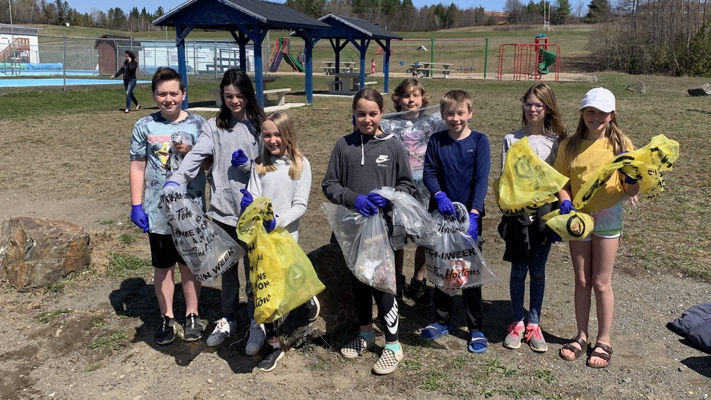 A grade 5 class from Hartland Community School takes part in a spring clean-up on Saturday afternoon. The group also spent time cleaning up trash on Sunday. From left are Oliver Paget, Gracyn Wilson, Sophia Lloyd, Vada Bradstreet, Thomas Foster, Ty Clouse, Skye Hudson and Sophie Mangum.