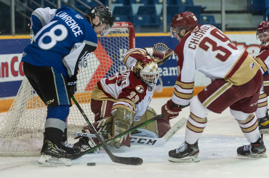 Titan goalie Chad Arsenault tries to defend the net during a playoff game against the Saint John Sea Dogs at TD Station Sunday night. The team lost 2-6.