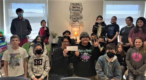 Kelly Stephenson's Grade 7 class at Perth-Andover Middle School recently raised enough money to purchase a water tank for a school in Kenya, along with a cook stove with a chimney, garden bags with seeds and modifications to make a washroom accessible.