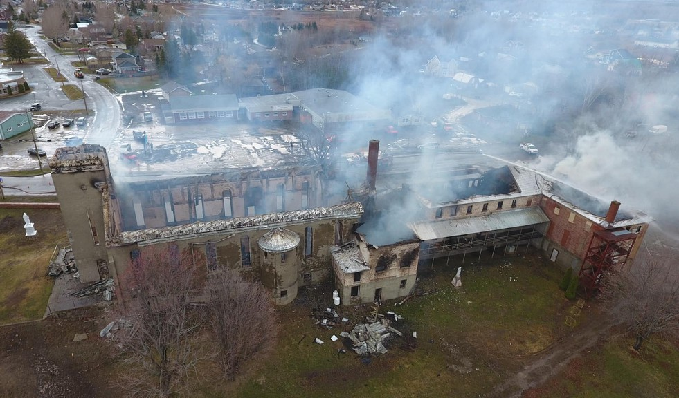 This in an aerial view of the still smoldering remnants of St. Anne's Roman Catholic Church in Listuguj First Nation on Tuesday afternoon. The fire that destroyed the building late Monday night into Tuesday morning is still under investigation.