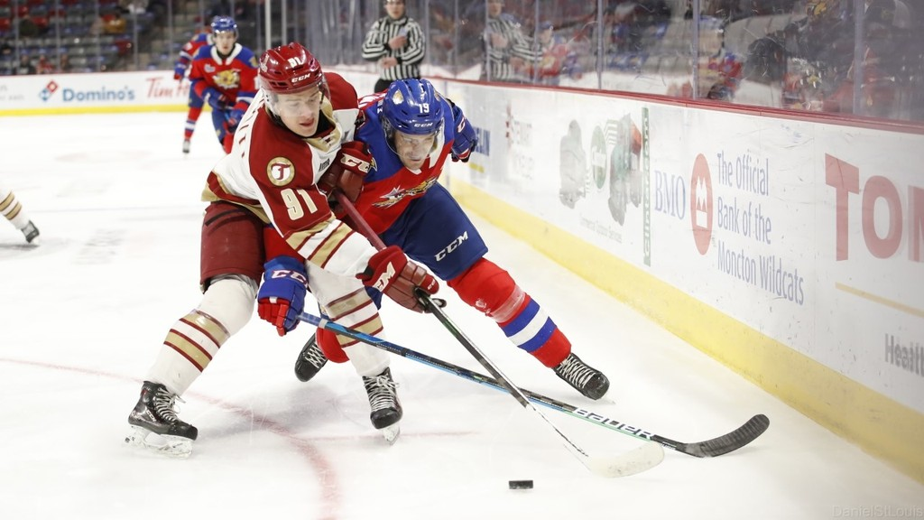 The Acadie-Bathurst Titan's Felix-Antoine Marcotty and Jacob Stewart of the Moncton Wildcats battle for the puck in Quebec Major Junior Hockey League playoff action on Wednesday night at the Avenir Centre.