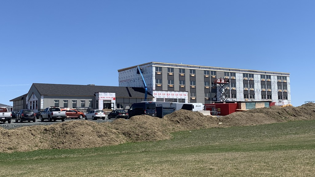 Crews work on the Florenceville Amsterdam Inn and Suites hotel, which is under construction for an expected opening this July.