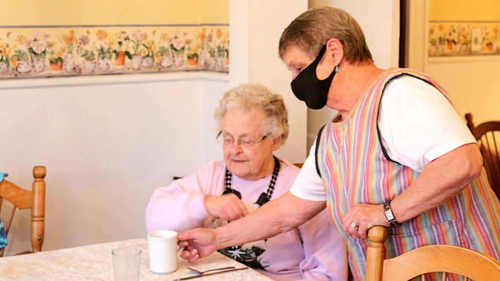 Marion Briand, matron at the New Brunswick Women's Institute Home in Woodstock, serves tea to Eleanor Love at the Chapel Street home on Friday. The women's institute is closing the doors on the not-for-profit facility on May 31, evicting nine senior ladies.