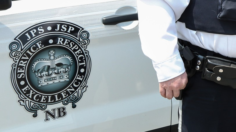 The Department of Justice and Public Safety badge is seen on an emergency vehicle.