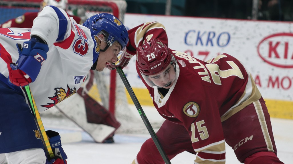 The Acadie-Bathurst Titan's Ben Allison faces off against Moncton's Nicolas Pavan during the final game of the first round of Quebec Major Junior Hockey League playoffs. The Titan play the Charlottetown Islanders in the Maritime division final in Quebec beginning Saturday.