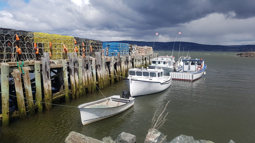 Traps for the commercial lobster fishery sit on a wharf in Dalhousie used by fishers from Eel River Bar (Ugpi'Ganjig) First Nation. The fishery was to start May 4, delayed from May 1 due to windy weather.