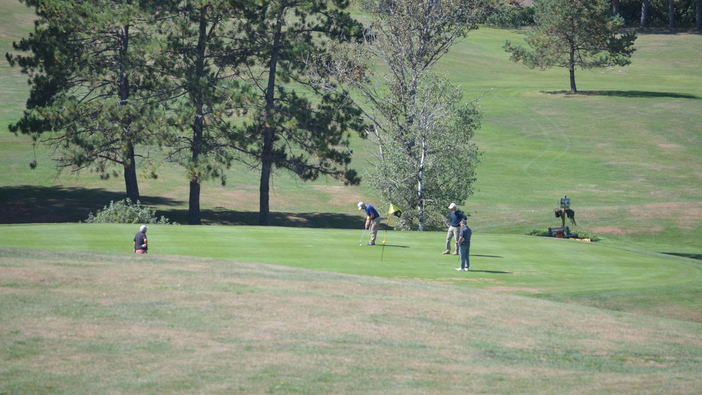 The Plaster Rock Golf Club has opened for the season two weeks earlier than usual due to a mild spring. In this file photo, golfers are seen on the nine-hole course last September.