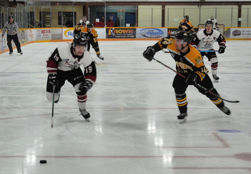 Miramichi Timberwolves forward Evan MacKinnon, 19, and Campbellton Tigers defenceman Frédéric Castonguay chase the puck during Game 1 of the Maritime Junior Hockey League's best-of-five Eastlink North Division semifinal Wednesday at Miramichi Civic Centre. MacKinnon scored twice in the Wolves' 5-3 win.