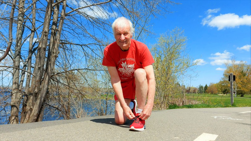 With prostate cancer in remission for the second time, Fredericton's Phil Booker, 78, resumed running and is shown when he reached the 500-straight day milestone in May. His streak stretched to 595 days before he unexpectedly had to undergo colon cancer on Aug. 15.