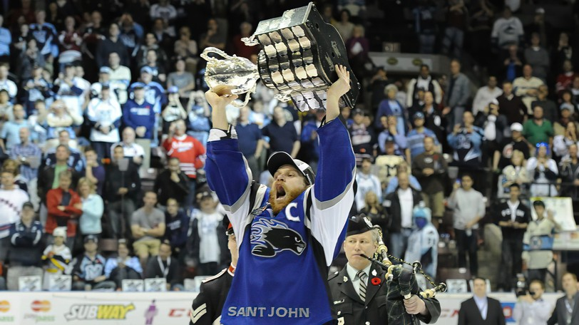 Saint John Sea Dogs captain Mike Thomas hoists the Memorial Cup in 2011 in this file photo. The Canadian Hockey League announced Wednesday that the Sea Dogs will host the 2022 Memorial Cup.
