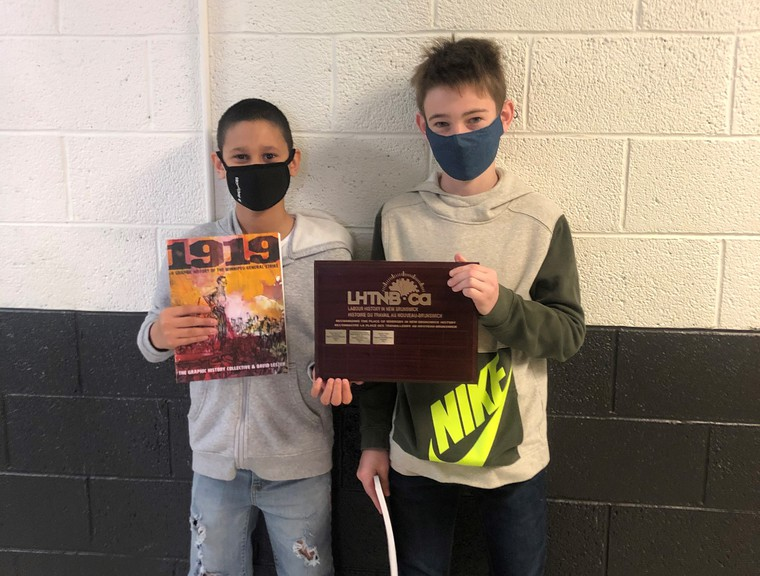 Tobique Valley Middle High School students, from left, Landon Douglas and Aaden Brayall received the N.B. Labour History Award at the regional heritage fair held virtually on May 20 for their project on McCain Foods.
