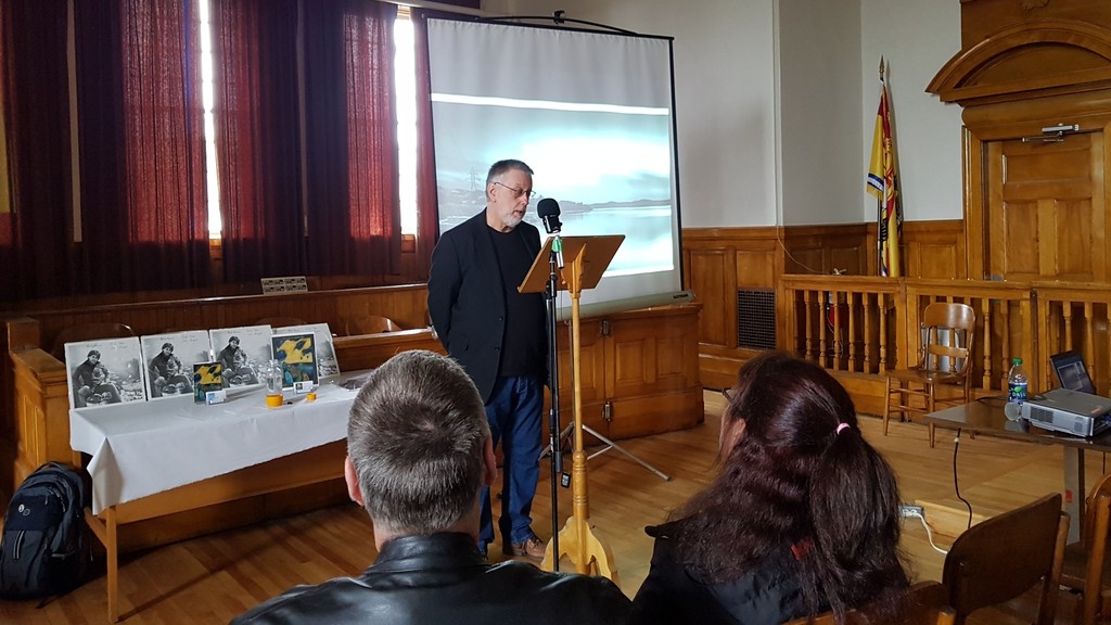 Dalhousie-born poet and singer Bob Jensen is shown reading some of his poems at the Restigouche Regional Museum in his hometown a couple of years ago. Jensen, who was touring Australia doing spoken-word poetry over music when the pandemic hit, has released a new collection of poems called A Sense of Wonder.