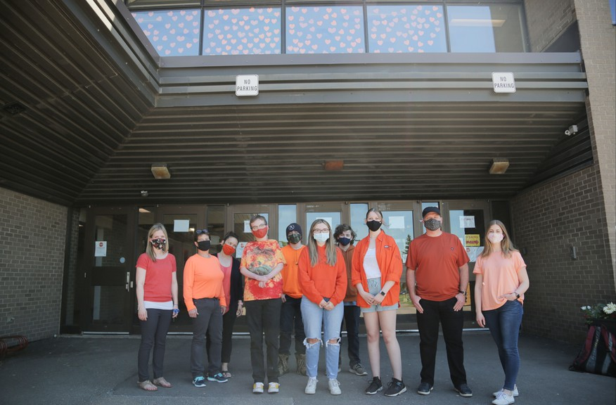 Students and teachers at the Sussex Regional High School wore orange this week to show awareness and support after the graves of 215 Indigenous children were found at the site of the Kamloops Indian Residential School in B.C. Above the students are 215 orange hearts displayed on the school windows that represent each Indigenous child who was found.