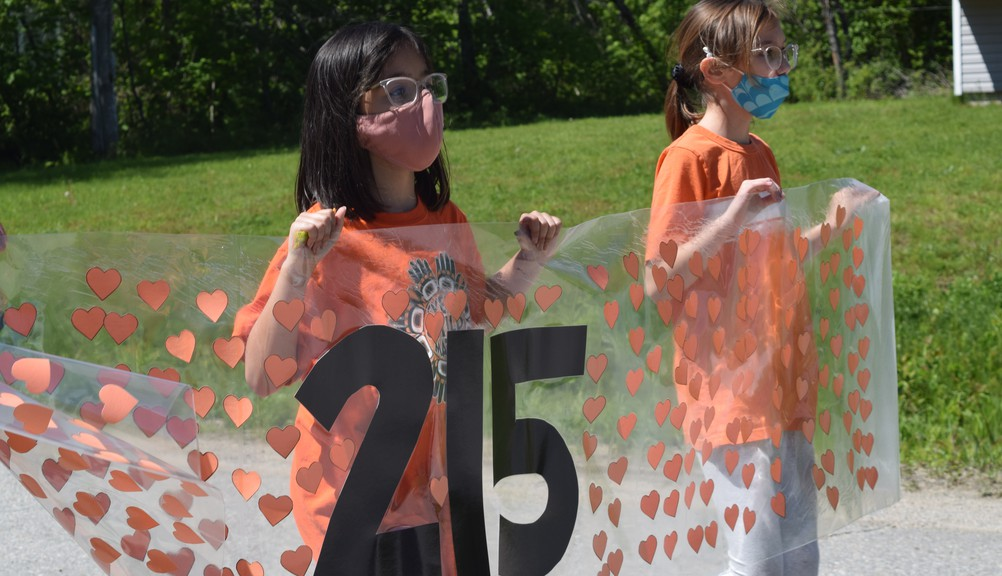 The streets of Metepenagiag Mi'kmaq Nation were flooded with orange shirts on Wednesday morning as people marched in memory of the 215 children whose remains were found on the grounds of the former Kamloops Indian Residential School in British Columbia.