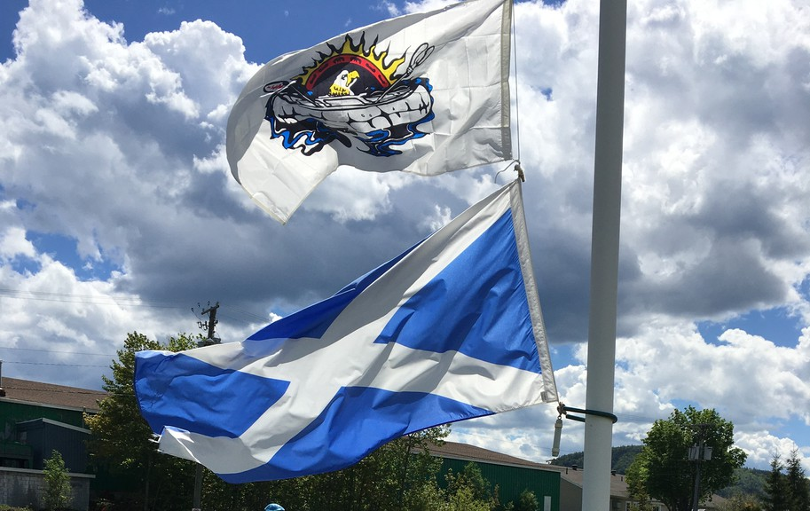 Ian Hamilton, the president of the Restigouche Caledonia Society, along with member Allan Dickson, added the flag of Eel River Bar (Ugpi'Ganjig) First Nation to the Scottish flag at the Scottish monument in Campbellton Thursday to recognize the remains of 215 children that were found on the site of a former residential school in Kamloops, B.C. on May 27.