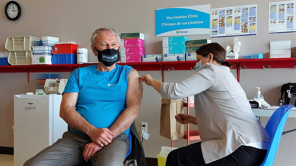 Dr. Jennifer Russell gives Premier Blaine Higgs his second dose of AstraZeneca's vaccine against COVID-19 at a clinic in Fredericton on Friday.