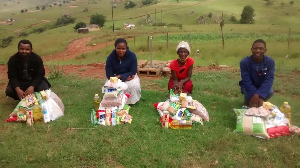 In this week's column, Mark Bettle writes about the economic impacts the COVID-19 pandemic is having on Swaziland, and how part of the funds raised at the Hampton Pigs Peak Partnership Garden Party on June 12 will go toward buying groceries for their partner families, as pictured.