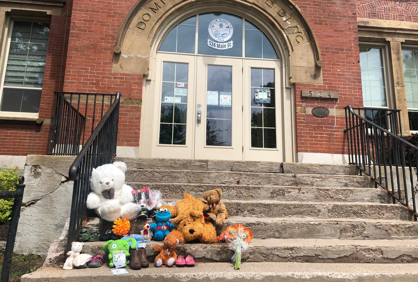 A small memorial to the 215 Indigenous children whose bodies were found in unmarked graves at the Kamloops Indian Residential School last week started with an anonymous individual and is growing larger on the steps of the town hall in Sussex.