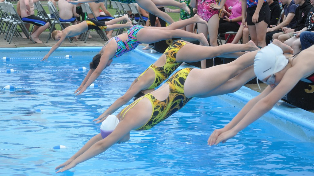 Swimmers dive into the Plaster Rock swimming pool in this file photo from 2019. Registration for swim team, swimming lessons and baseball is open in Plaster Rock with more activities in the planning stages.
