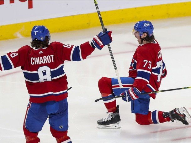 Canadiens' Tyler Toffoli celebrates his game- and series-winning goal with teammate Ben Chiarot Monday night at the Bell Centre, as the Habs beat the Jets 3-2 to complete a four-game sweep.