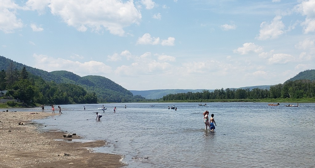 People cooled off at Tide Head Beach on Monday, June 7, as unseasonable hot weather set a new record in the area. A record high was set the next day as well.