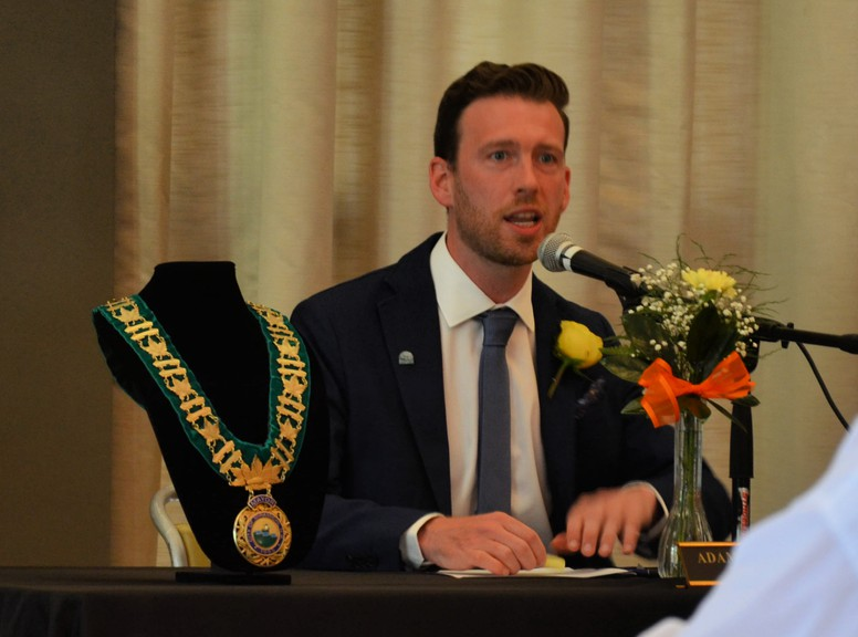 Miramichi Mayor Adam Lordon speaks before the swearing-in ceremony for the new city council Monday at the Beaverbrook Kin Centre.