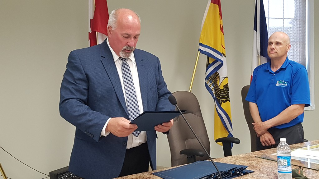Dalhousie council was sworn in on June 7. Here Mayor Normand Pelleter takes the oath of office, while Clerk-Treasurer Gilles Legacy looks on.