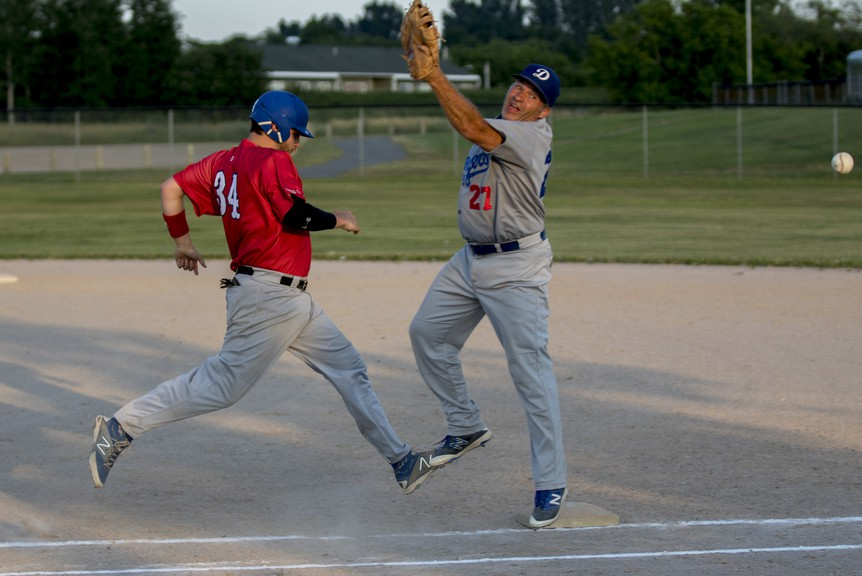 Andrew Carter, 34, formerly of the Chaleur Red Sox, darts toward first base after Serge Gendron of the Dalhousie Dodgers missed the catch during the 2019 Miramichi Valley Baseball League season. Carter has been acquired by the Miramichi Mike's Bar and Grill Cardinals ahead of the league's 2021 campaign.