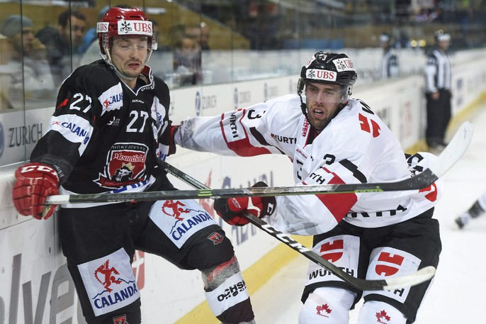 Former Moncton Wildcats defenceman Brandon Gormley, right, seen playing for Canada at the 2017 Spengler Cup hockey tournament in Davos, Switzerland, has signed with Dinamo Riga of the KHL.