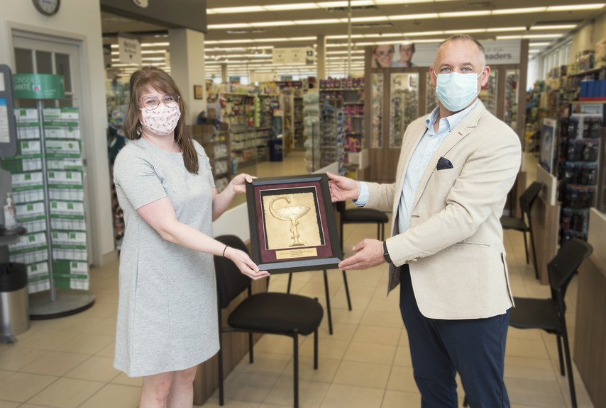 Bathurst pharmacist Brian Fitzpatrick, right, was given the 2021 Bowl of Hygeia Award for going beyond his duties as a pharmacist while serving the community. New Brunswick Pharmacists' Association President Christine Boudreau presented him with the award.