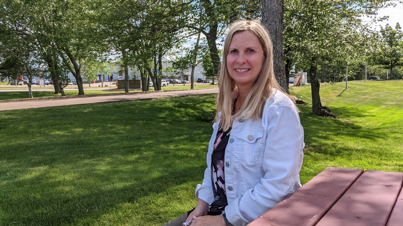 Heather Stordy sits outside the Anglophone East School District offices in Moncton in June. Stordy is the community response co-ordinator with the district and is a member of the Riverview Youth Network.