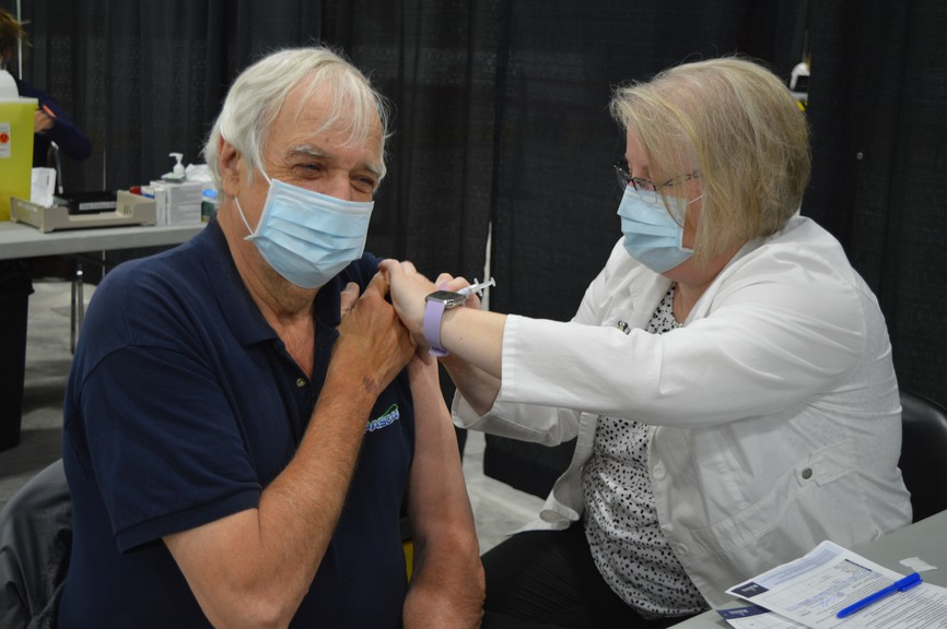Petit-Rocher mayor and nurse Rachel Boudreau is pictured administering a COVID-19 vaccine to Wayne Cormier during a clinic held at the K.C. Irving Regional Centre Saturday.