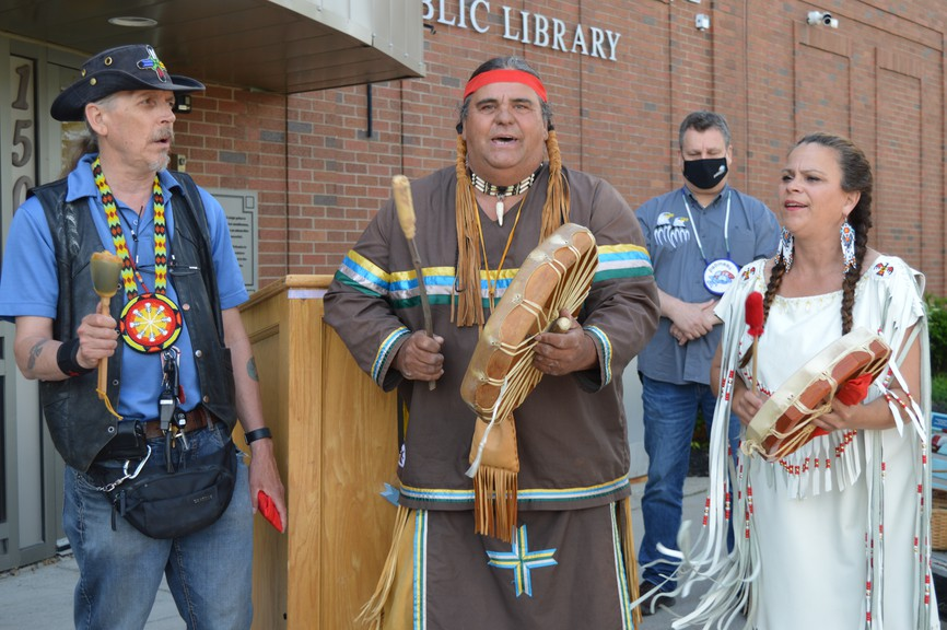 The City of Bathurst, in partnership with Pabineau First Nation, held a ceremony and flag raising to mark National Indigenous Peoples Day on Monday. Pictured are Pabineau First Nation members Steven Randy Peter-Paul, Warren Brown and Rosemarie Boucher (Sparks) singing the honour song during the ceremony. Pabineau First Nation Chief Terry Richardson can be seen in the background.