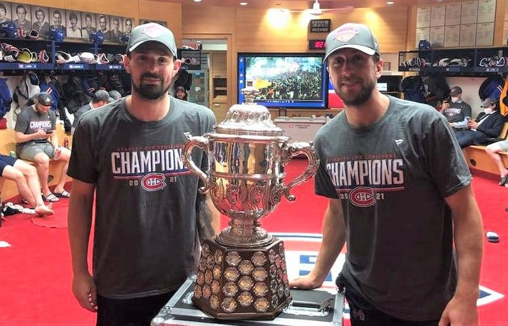 Montreal Canadiens goaltenders Carey Price, left, and Jake Allen of Fredericton pose for a photo with the Clarence S. Campbell Bowl in the team's dressing room after Montreal eliminated the Vegas Golden Knights in the 2021 NHL playoffs. Price has entered a player assistance program - for unspecified reasons - with his wife's encouragement. The program helps players and their families deal with substance abuse, mental health and other matters.